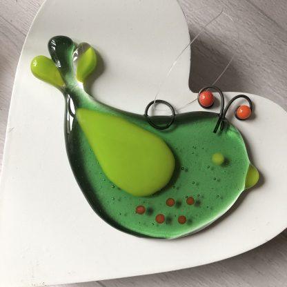 Green glass bird sun catcher